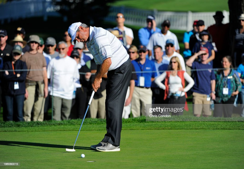 <a gi-track='captionPersonalityLinkClicked' href=/galleries/search?phrase=Fred+Couples&family=editorial&specificpeople=203076 ng-click='$event.stopPropagation()'>Fred Couples</a> putts for birdie on the 16th hole during the second round of the Charles Schwab Cup Championship at TPC Harding Park on November 1, 2013 in San Francisco, California.