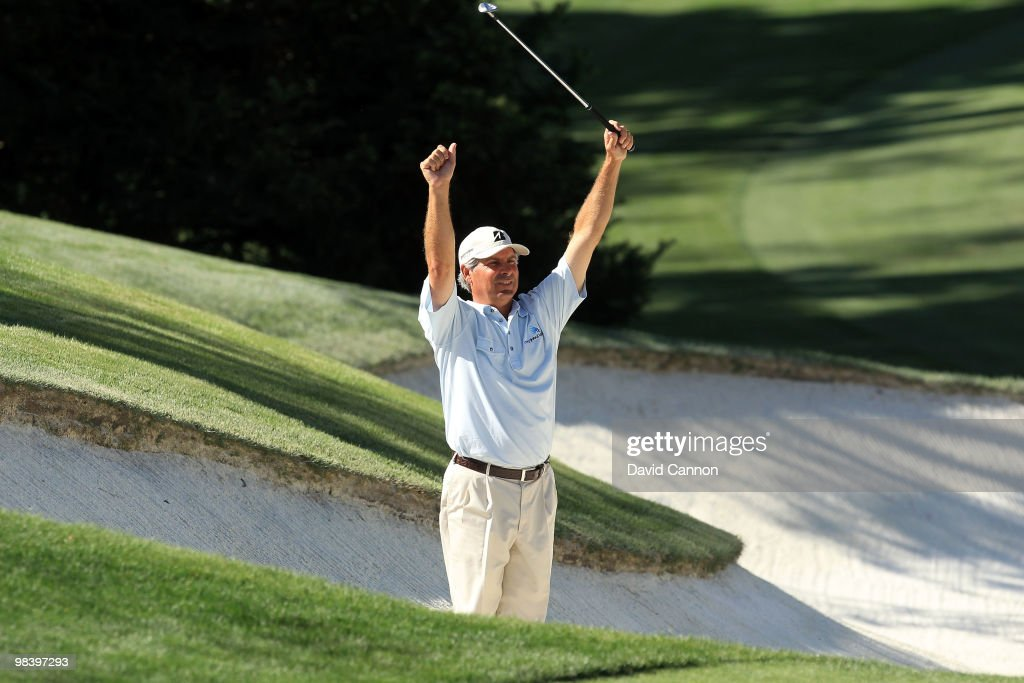 Fred Couples reacts to his shot from a bunker on the tenth hole during the final round of the 2010 Masters Tournament at Augusta National Golf Club on April 11, 2010 in Augusta, Georgia.