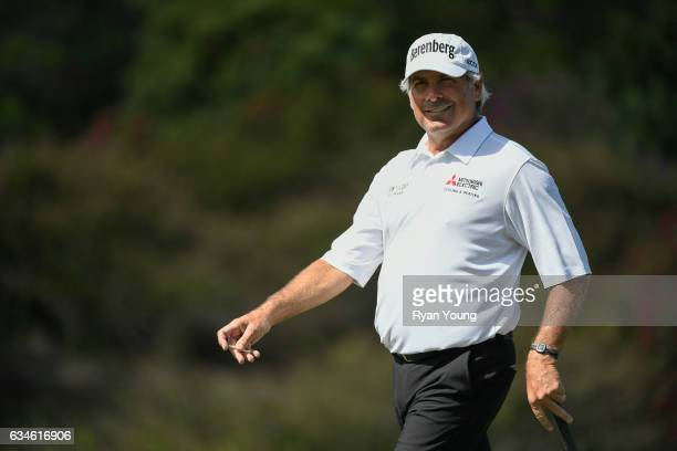 Fred Couples smiles at fans as he walks on the eighth green during the first round of the PGA TOUR Champions Allianz Championship at The Old Course...