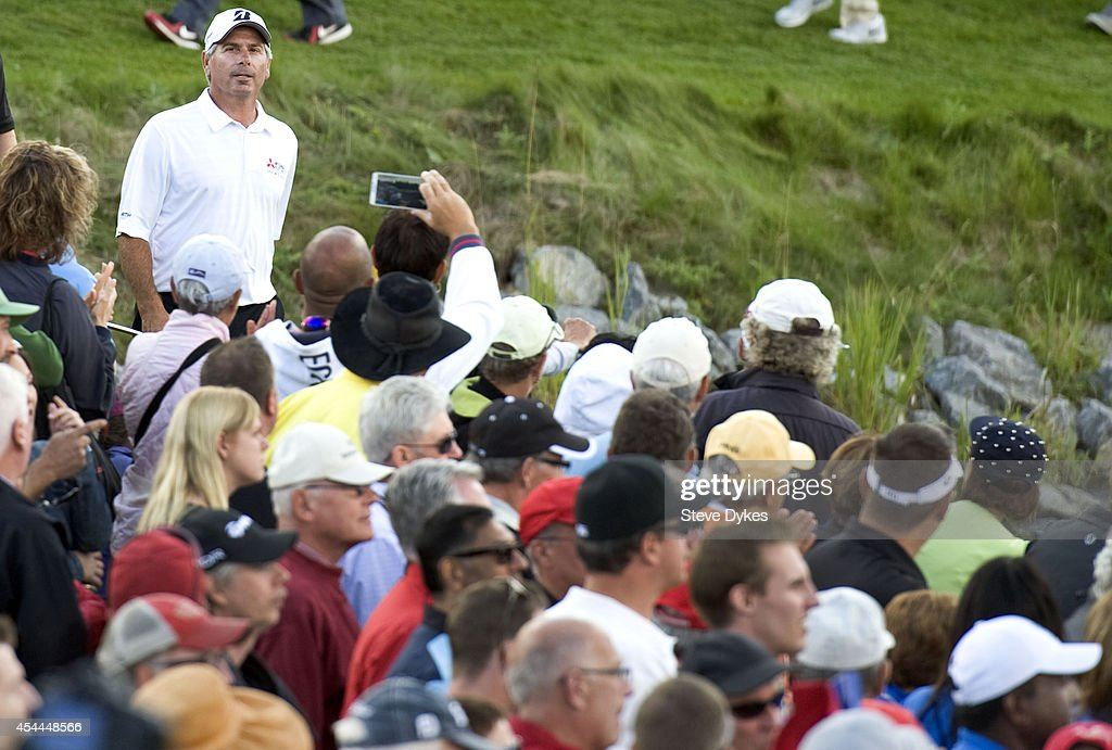 <a gi-track='captionPersonalityLinkClicked' href=/galleries/search?phrase=Fred+Couples&family=editorial&specificpeople=203076 ng-click='$event.stopPropagation()'>Fred Couples</a> walks to the 18th green during his playoff with Billy Andrade after the final round of the Shaw Charity Classic at the Canyon Meadows Golf & Country Club on August 31, 2014 in Calgary, Canada.