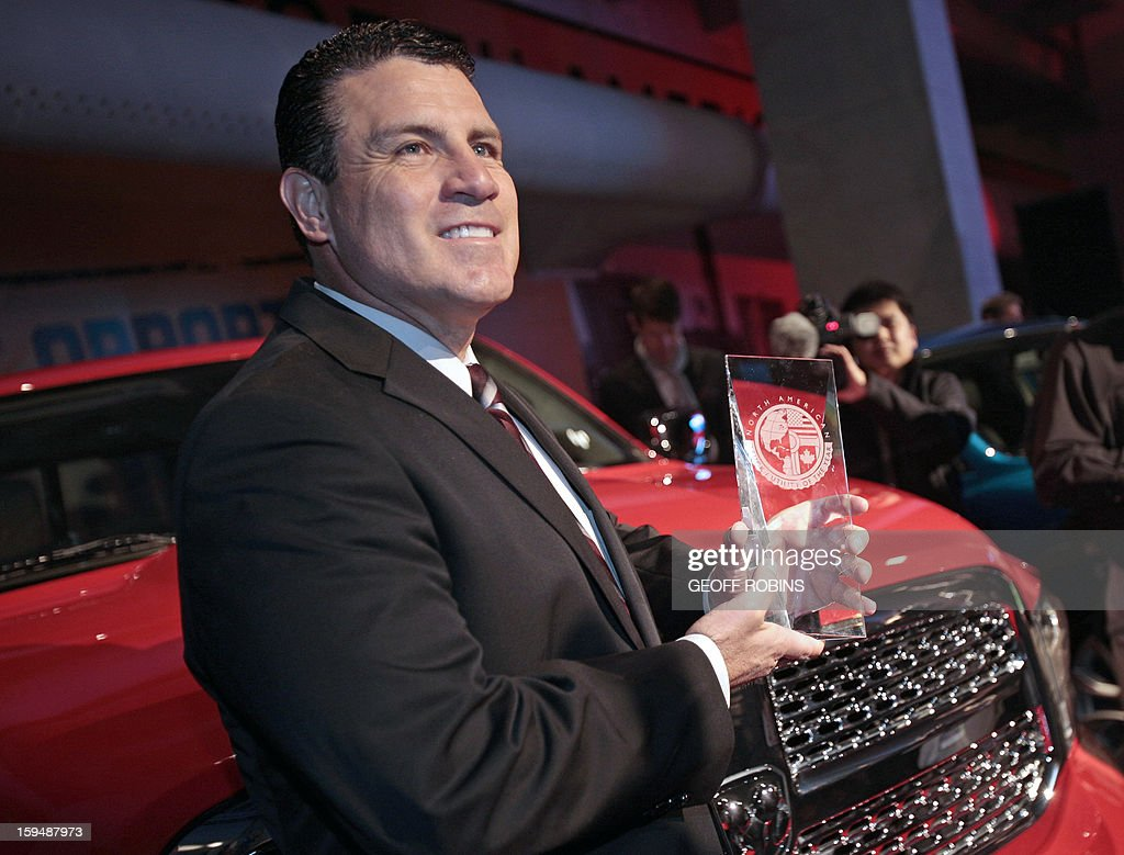 Fred Diaz, President and Chief Executive Officer - Ram Truck Brand, poses with the Ram 1500, named the North American Truck of the year at the 2013 North American International Auto Show in Detroit, Michigan, January 14, 2013. AFP PHOTO/Geoff Robins