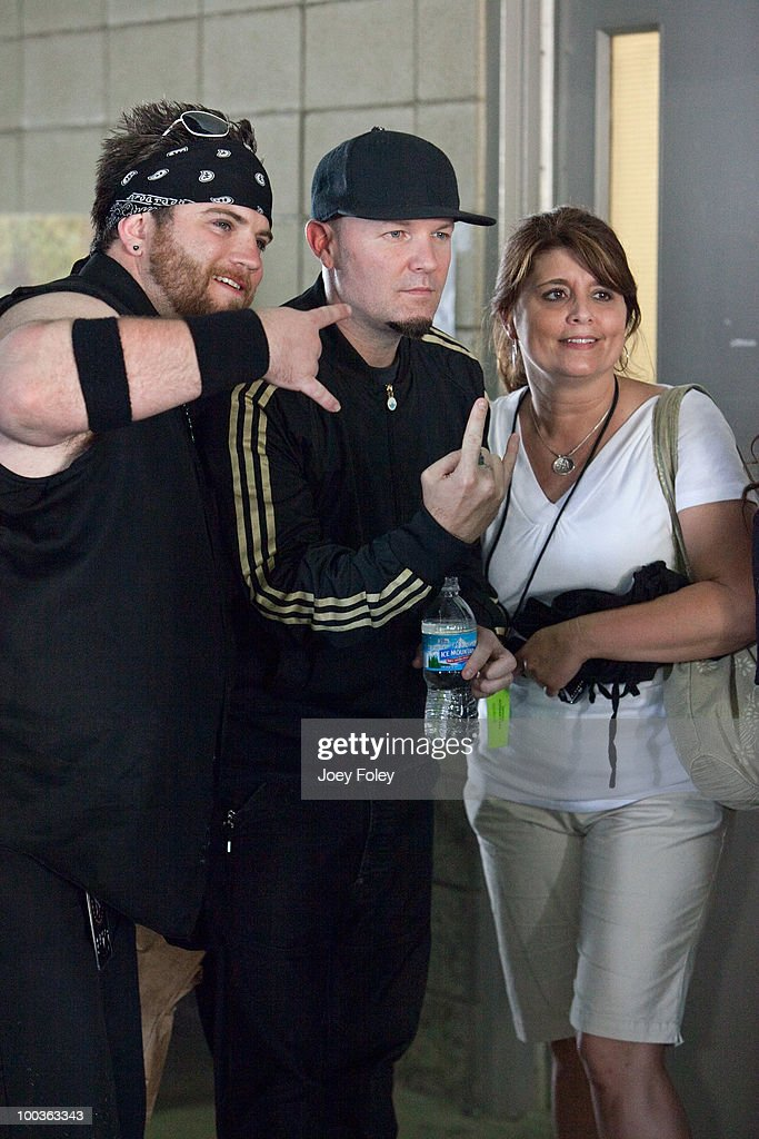 Fred Durst (C) of Limp Bizkit poses for a photo with some fans backstage during the 2010 Rock On The Range festival at Crew Stadium on May 23, 2010 in Columbus, Ohio.