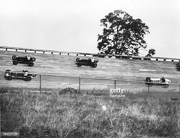 Fred Frame leads a trio of competitors during a race on the half mile Woodbridge Speedway board track The facility operated with a board surface from...