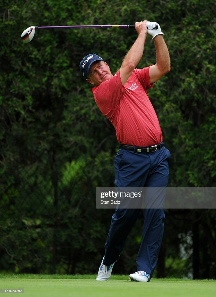 <a gi-track='captionPersonalityLinkClicked' href=/galleries/search?phrase=Fred+Funk&family=editorial&specificpeople=206374 ng-click='$event.stopPropagation()'>Fred Funk</a> hits a drive on the eighth hole during the first round of the Encompass Championship at North Shore Country Club on June 21, 2013 in Glenview, Illinois.