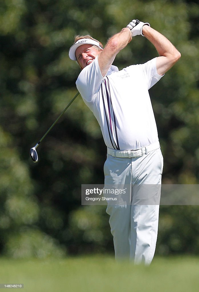 <a gi-track='captionPersonalityLinkClicked' href=/galleries/search?phrase=Fred+Funk&family=editorial&specificpeople=206374 ng-click='$event.stopPropagation()'>Fred Funk</a> watches his tee shot on the ninth hole during the first round of the 2012 Senior United States Open at Indianwood Golf and Country Club on July 12, 2012 in Lake Orion, Michigan.