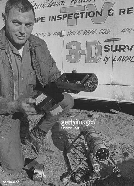 Fred Guildner of Wheat Ridge and his twoeyed sewer camera for 'taking filthy pictures underground' He's about to load 29millimeter film cartridge in...