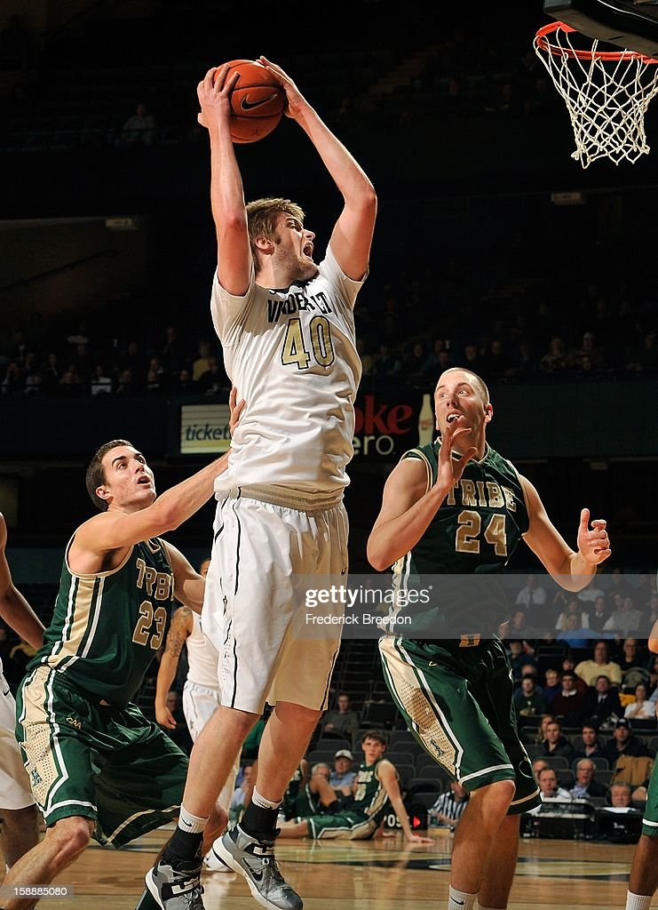 Fred Heldring #24 of William & Mary watches <a gi-track='captionPersonalityLinkClicked' href=/galleries/search?phrase=Josh+Henderson+-+Basquetebolista&family=editorial&specificpeople=15212566 ng-click='$event.stopPropagation()'>Josh Henderson</a> #40 of the Vanderbilt Commodores rebound a ball at Memorial Gym on January 2, 2013 in Nashville, Tennessee.
