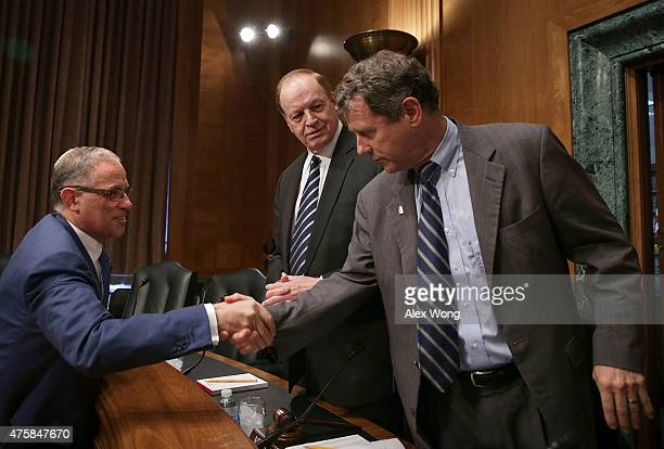 Fred Hochberg Chairman and President of the ExportImport Bank of the United States shakes hands with committee ranking member Sen Sherrod Brown as...
