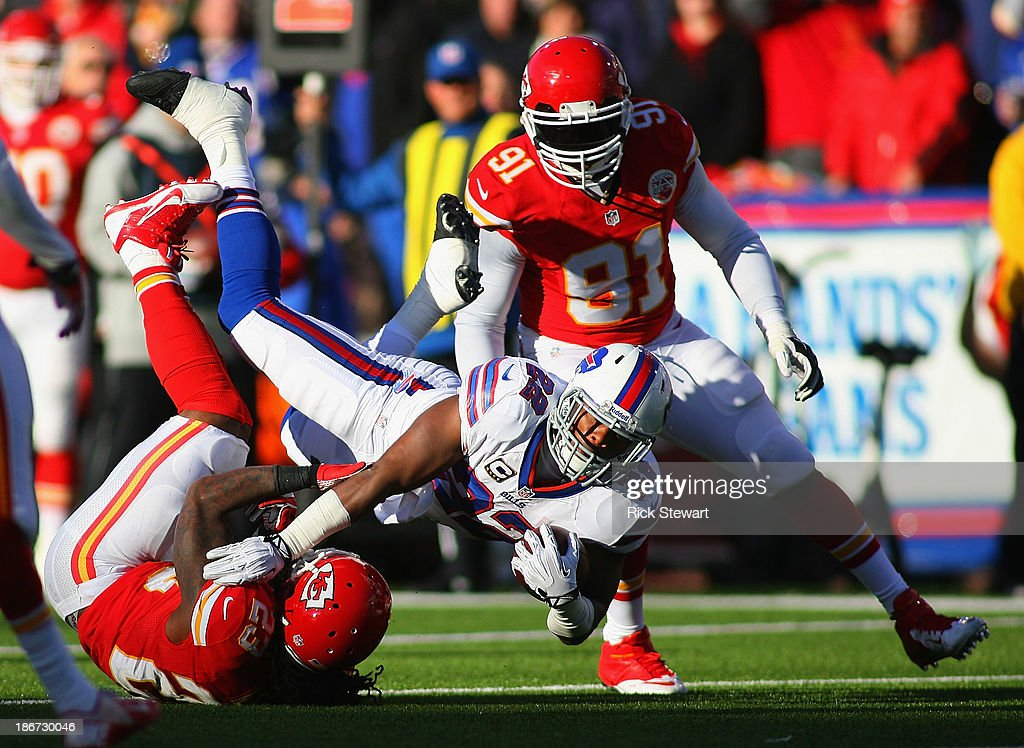 Fred Jackson #22 of the Buffalo Bills falls forward for a first down against <a gi-track='captionPersonalityLinkClicked' href=/galleries/search?phrase=Kendrick+Lewis&family=editorial&specificpeople=4501037 ng-click='$event.stopPropagation()'>Kendrick Lewis</a> #23 and outside linebacker <a gi-track='captionPersonalityLinkClicked' href=/galleries/search?phrase=Tamba+Hali&family=editorial&specificpeople=630576 ng-click='$event.stopPropagation()'>Tamba Hali</a> #91 of the Kansas City Chiefs at Ralph Wilson Stadium on November 3, 2013 in Orchard Park, New York. Kansas City won 23-13.