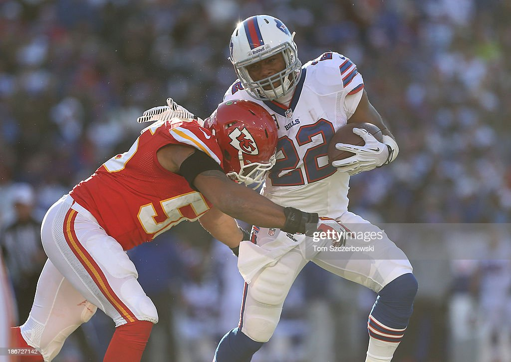 Fred Jackson #22 of the Buffalo Bills is tackled as he runs with the ball during NFL game action by Derrick Johnson #56 of the Kansas City Chiefs at Ralph Wilson Stadium on November 3, 2013 in Orchard Park, New York.