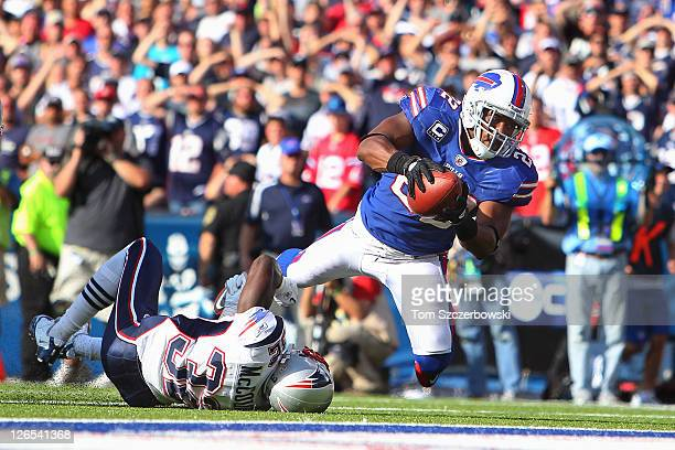 Fred Jackson of the Buffalo Bills is tackled at the 1yard line by Devin McCourty of the New England Patriots late in the fourth quarter at Ralph...