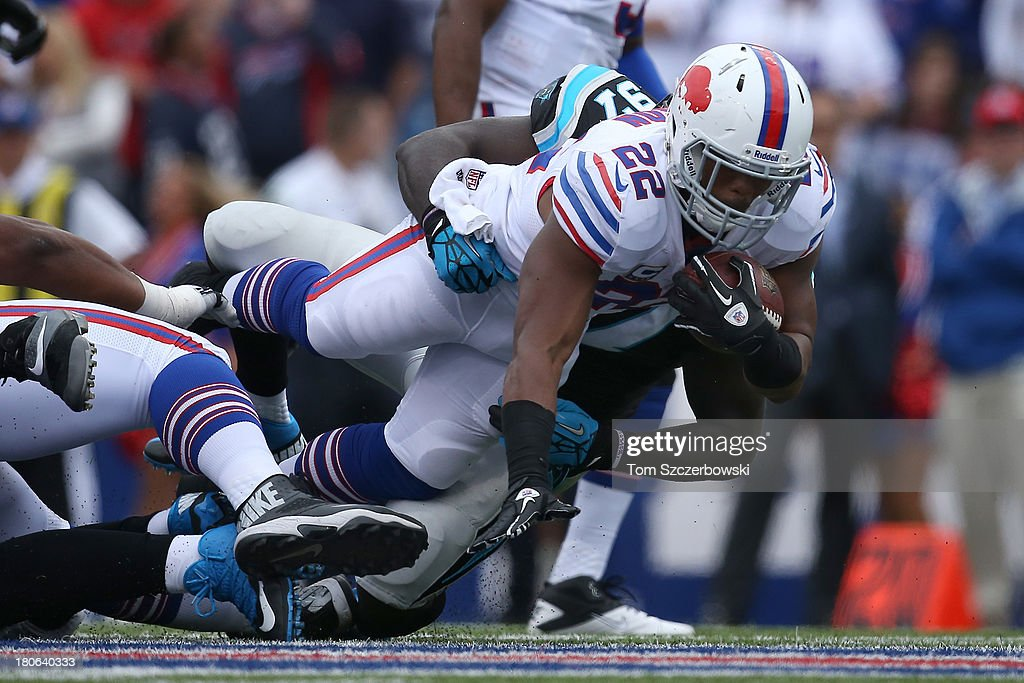 Fred Jackson #22 of the Buffalo Bills is tackled during NFL game action by Mario Addison #97 of the Carolina Panthers at Ralph Wilson Stadium on September 15, 2013 in Orchard Park, New York.