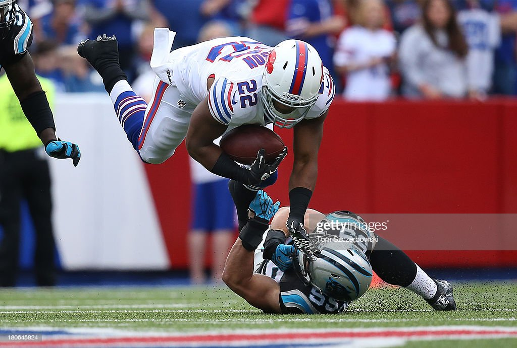 Fred Jackson #22 of the Buffalo Bills is tackled during NFL game action by <a gi-track='captionPersonalityLinkClicked' href=/galleries/search?phrase=Luke+Kuechly&family=editorial&specificpeople=6234948 ng-click='$event.stopPropagation()'>Luke Kuechly</a> #59 of the Carolina Panthers at Ralph Wilson Stadium on September 15, 2013 in Orchard Park, New York.