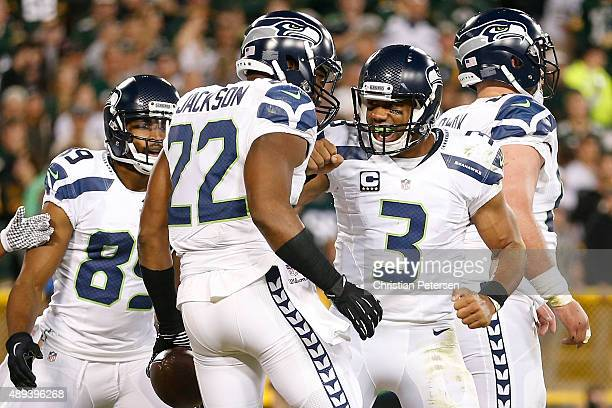 Fred Jackson of the Seattle Seahawks celebrates after catching a touchdown pass from Russell Wilson in the third quarter against the Green Bay...