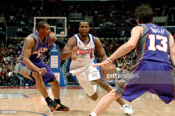 Fred Jones of the Los Angeles Clippers drives past Leandro Barbosa of the Phoenix Suns at Staples Center on February 18 2009 in Los Angeles...