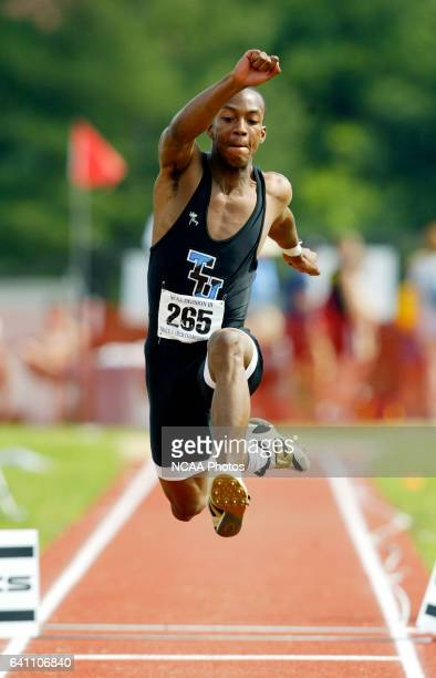 Fred Jones of Tufts University competes in the triple jump during the Division III Men's and Women's Track Field Championship held at Frank M Lindsay...