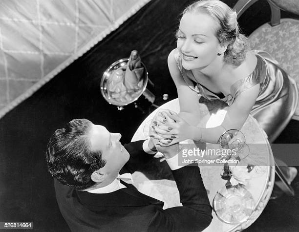 Fred MacMurray and Carole Lombard Holding Hands