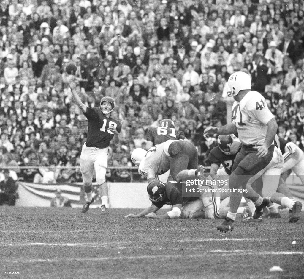 Fred Marshall of the Arkansas Razorbacks passinsgs against the Nebraska Huskers during the 1965 Cotton Bowl on January 1 1965 in Dallas Texas