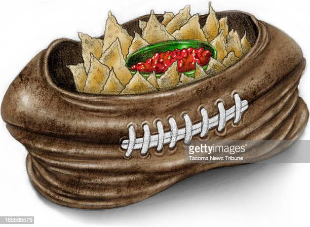 Fred Matamoros color illustration of chips and salsa served in a deflatedfootball bowl The News Tribune /MCT via Getty Images