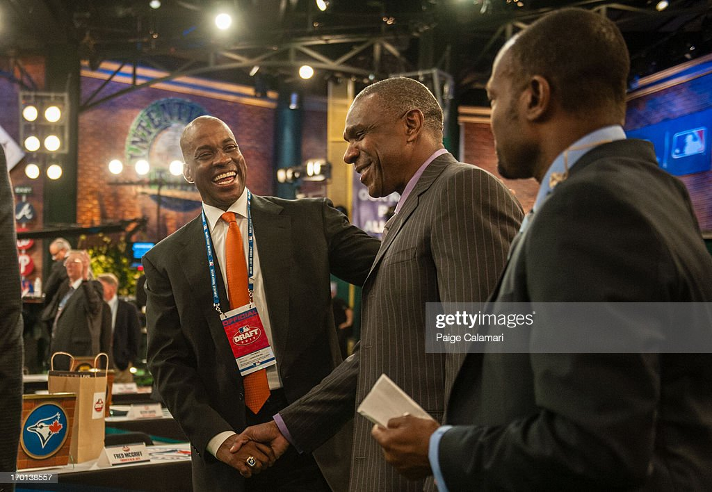 <a gi-track='captionPersonalityLinkClicked' href=/galleries/search?phrase=Fred+McGriff&family=editorial&specificpeople=216580 ng-click='$event.stopPropagation()'>Fred McGriff</a> laughs with Hall of Famer <a gi-track='captionPersonalityLinkClicked' href=/galleries/search?phrase=Andre+Dawson&family=editorial&specificpeople=206316 ng-click='$event.stopPropagation()'>Andre Dawson</a> and <a gi-track='captionPersonalityLinkClicked' href=/galleries/search?phrase=Harold+Reynolds&family=editorial&specificpeople=211290 ng-click='$event.stopPropagation()'>Harold Reynolds</a> during the 2013 First-Year Player Draft at MLB Network's Studio 42 on June 6, 2013 in Secaucus, New Jersey.