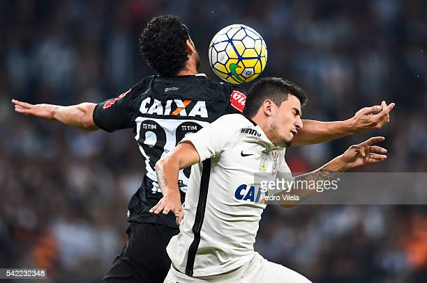 Fred of Atletico MG and Pedro Henrique of Corinthians battle for the ball during a match between Atletico MG and Corinthians as part of Brasileirao...