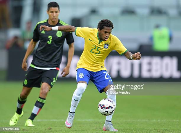 Fred of Brazil and Hugo Ayala of Mexico compete for the ball during the International Friendly Match between Brazil and Mexico at Allianz Parque on...
