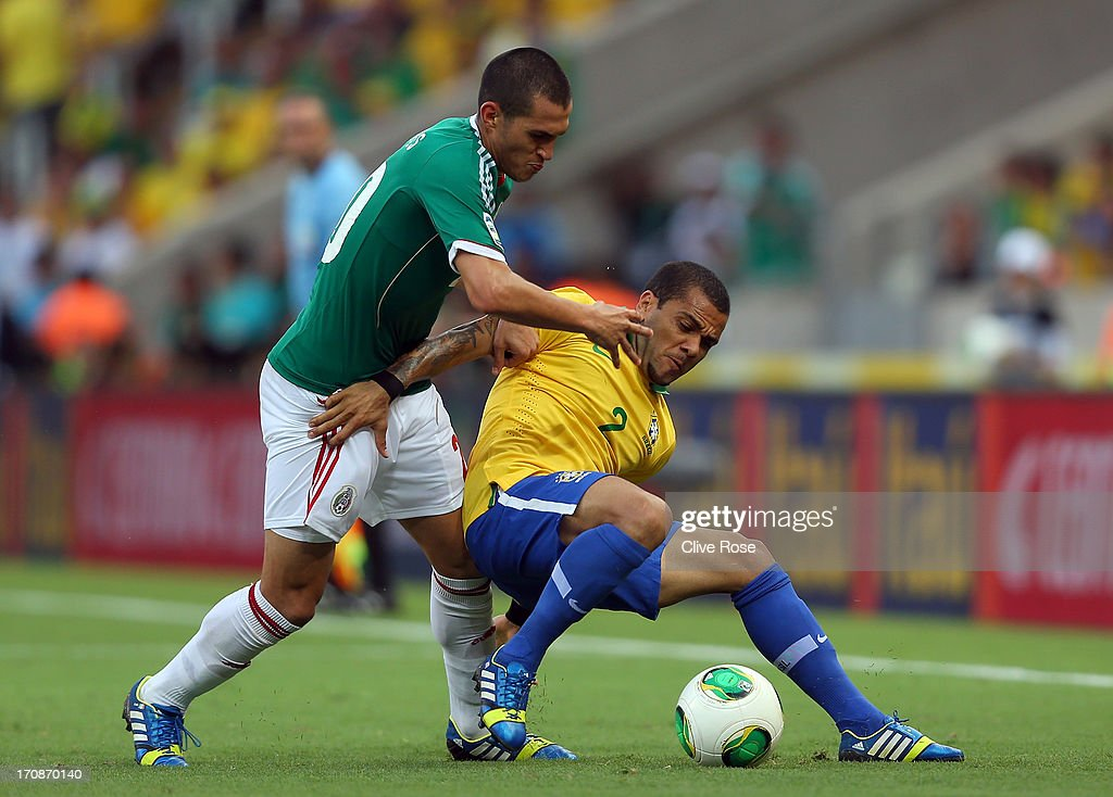 Fred of Brazil battles for the ball with Jorge Torres Nilo of Mexico during the FIFA Confederations Cup Brazil 2013 Group A match between Brazil and Mexico at Castelao on June 19, 2013 in Fortaleza, Brazil.