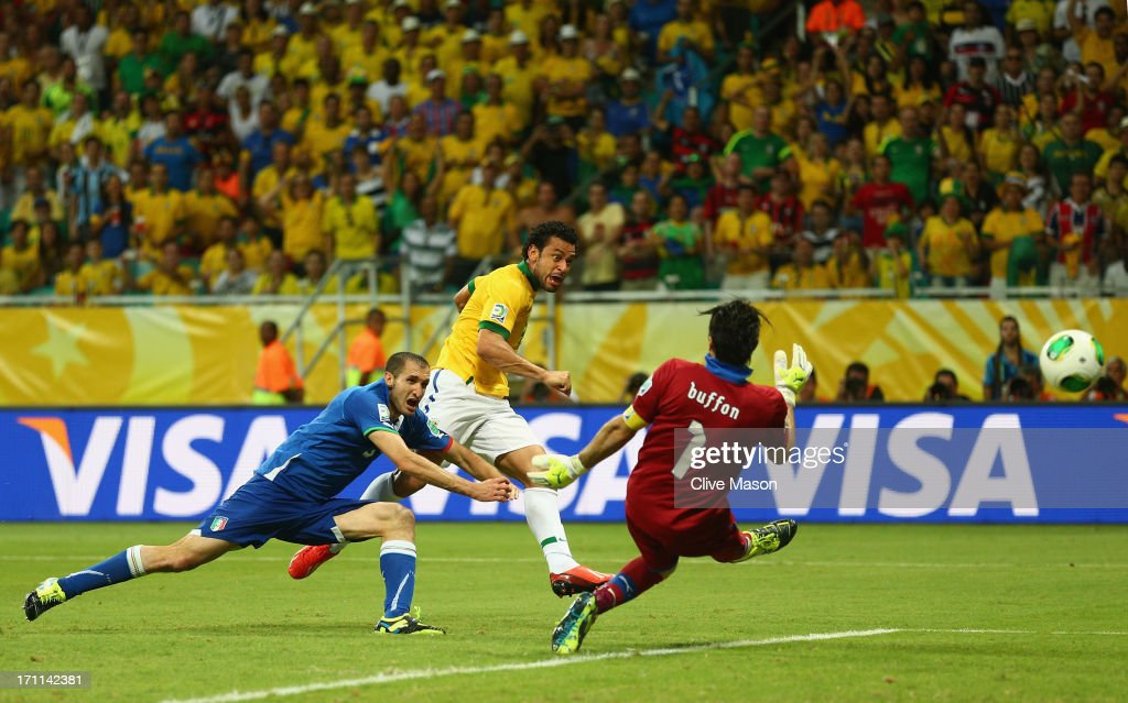 Fred of Brazil beats Giorgio Chiellini (L) and Gianluigi Buffon of Italy (R) to score their third goal during the FIFA Confederations Cup Brazil 2013 Group A match between Italy and Brazil at Estadio Octavio Mangabeira (Arena Fonte Nova Salvador) on June 22, 2013 in Salvador, Brazil.