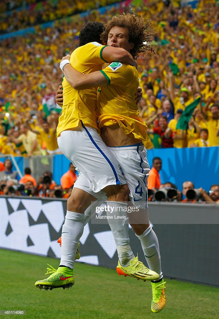 Fred of Brazil (L) celebrates scoring his team's third goal with David Luiz during the 2014 FIFA World Cup Brazil Group A match between Cameroon and Brazil at Estadio Nacional on June 23, 2014 in Brasilia, Brazil.