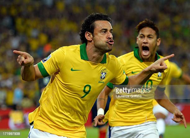 Fred of Brazil celebrates scoring the opening goal with teammate Neymar during the FIFA Confederations Cup Brazil 2013 Final match between Brazil and...