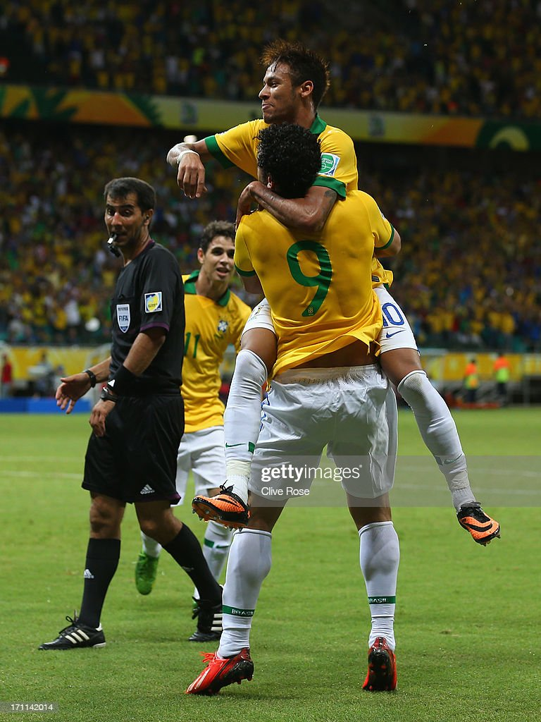 Fred of Brazil (9) celebrates with Neymar as he scores their third goal during the FIFA Confederations Cup Brazil 2013 Group A match between Italy and Brazil at Estadio Octavio Mangabeira (Arena Fonte Nova Salvador) on June 22, 2013 in Salvador, Brazil.