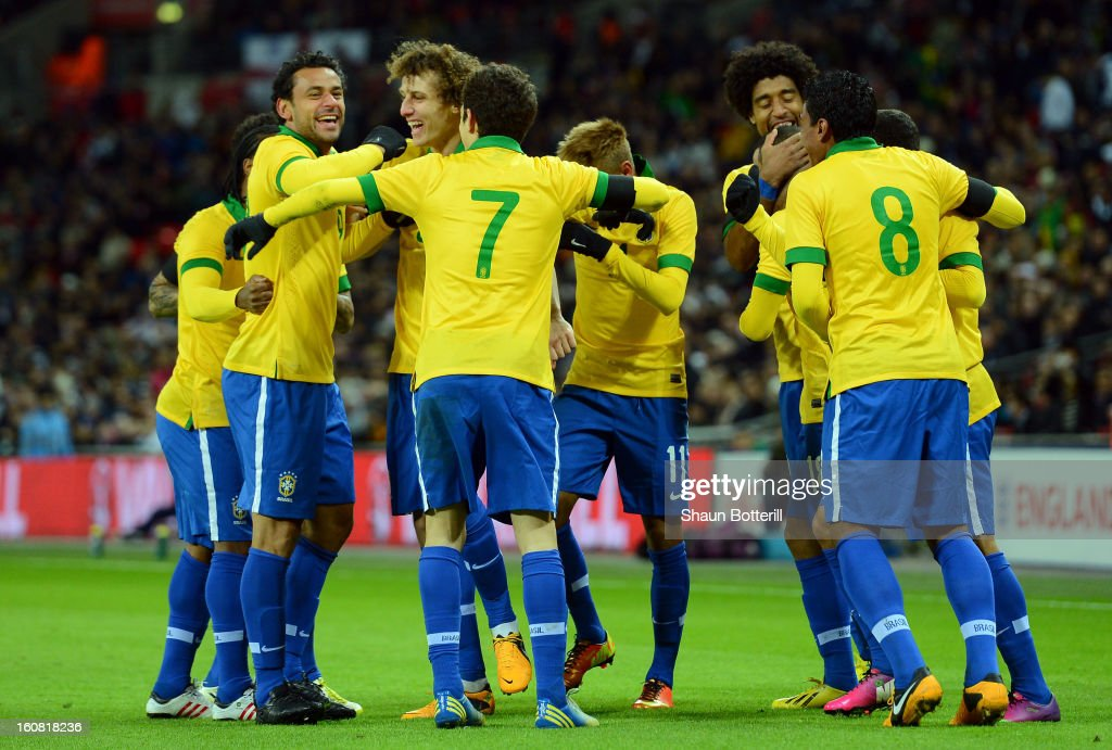 Fred of Brazil (L) celebrates with team-mates after scoring the equalising goal during the International friendly between England and Brazil at Wembley Stadium on February 6, 2013 in London, England.
