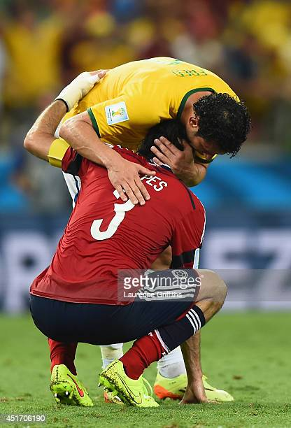 Fred of Brazil consoles Mario Yepes of Colombia after the 2014 FIFA World Cup Brazil Quarter Final match between Brazil and Colombia at Castelao on...