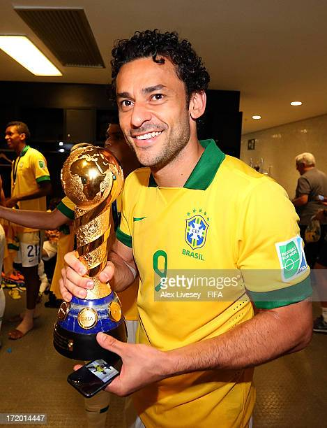 Fred of Brazil poses with the trophy at the end of the FIFA Confederations Cup Brazil 2013 Final match between Brazil and Spain at Maracana on June...