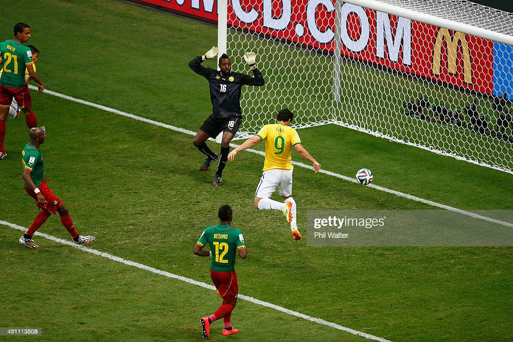 Fred of Brazil scores his team's third goal on a header past Charles Itandje of Cameroon during the 2014 FIFA World Cup Brazil Group A match between Cameroon and Brazil at Estadio Nacional on June 23, 2014 in Brasilia, Brazil.