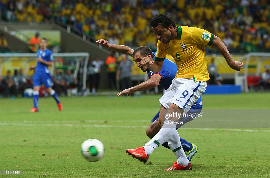 Fred of Brazil scores their third goal during the FIFA Confederations Cup Brazil 2013 Group A match between Italy and Brazil at Estadio Octavio Mangabeira (Arena Fonte Nova Salvador) on June 22, 2013 in Salvador, Brazil.
