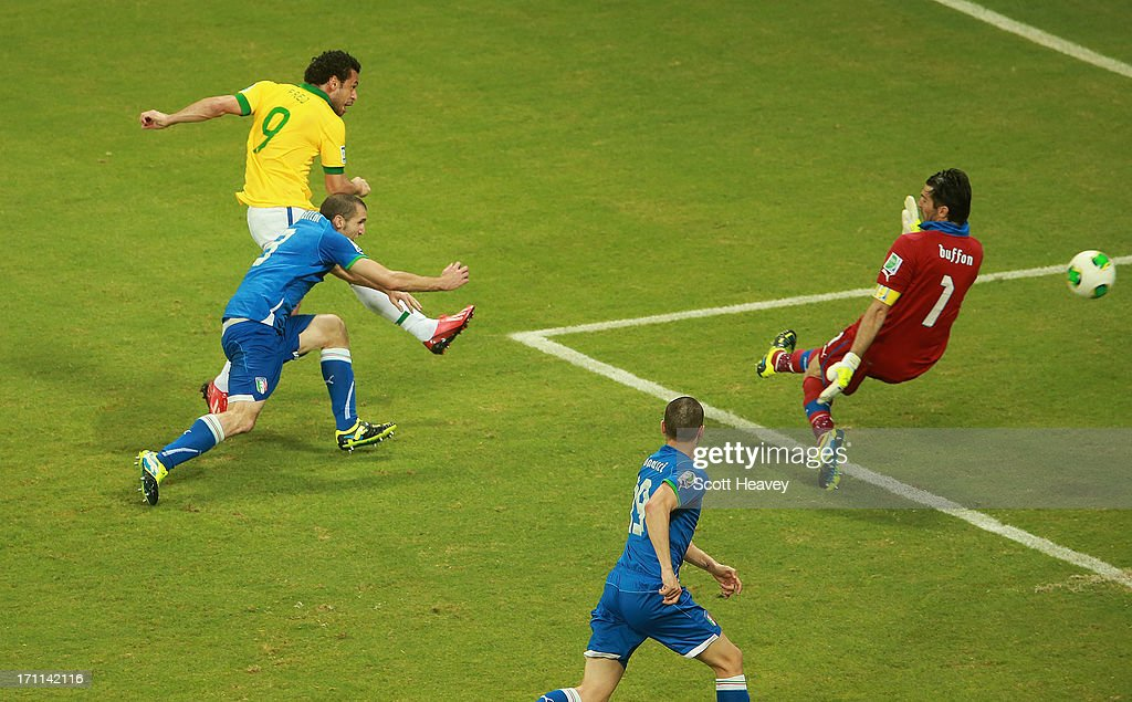 Fred of Brazil scores their third goal past goalkeeper Gianluigi Buffon of Italy during the FIFA Confederations Cup Brazil 2013 Group A match between Italy and Brazil at Estadio Octavio Mangabeira (Arena Fonte Nova Salvador) on June 22, 2013 in Salvador, Brazil.