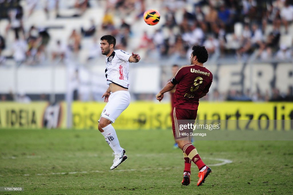 Fred (R) of Fluminense controls the ball during a match between Fluminense and Ponte Preta as part of the Brazilian Championship Serie A 2013 at Moises Lucarelli Stadium on August 04, 2013 in Campinas, Brazil.