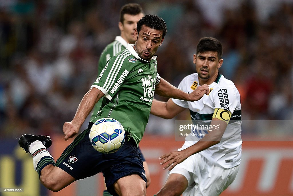 <a gi-track='captionPersonalityLinkClicked' href=/galleries/search?phrase=Fred+-+Fluminense+Football+Club&family=editorial&specificpeople=490870 ng-click='$event.stopPropagation()'>Fred</a> (L) of Fluminense struggles for the ball with a Leandro Almeida of Coritiba during a match between Fluminense and Coritiba as part of Brasileirao Series A 2015 at Maracana Stadium on June 04, 2015 in Rio de Janeiro, Brazil.