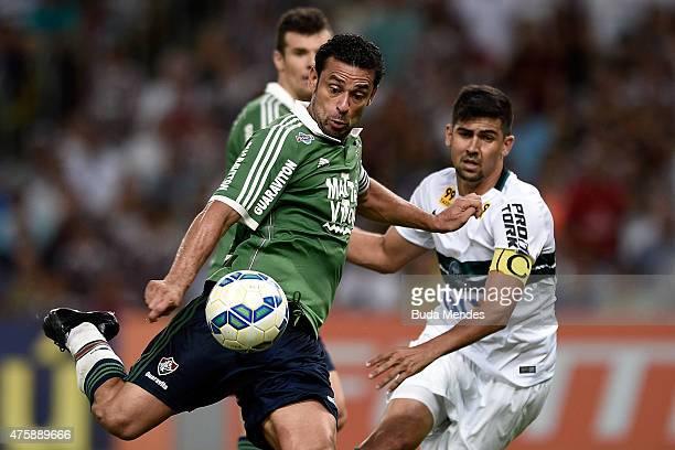 Fred of Fluminense struggles for the ball with a Leandro Almeida of Coritiba during a match between Fluminense and Coritiba as part of Brasileirao...