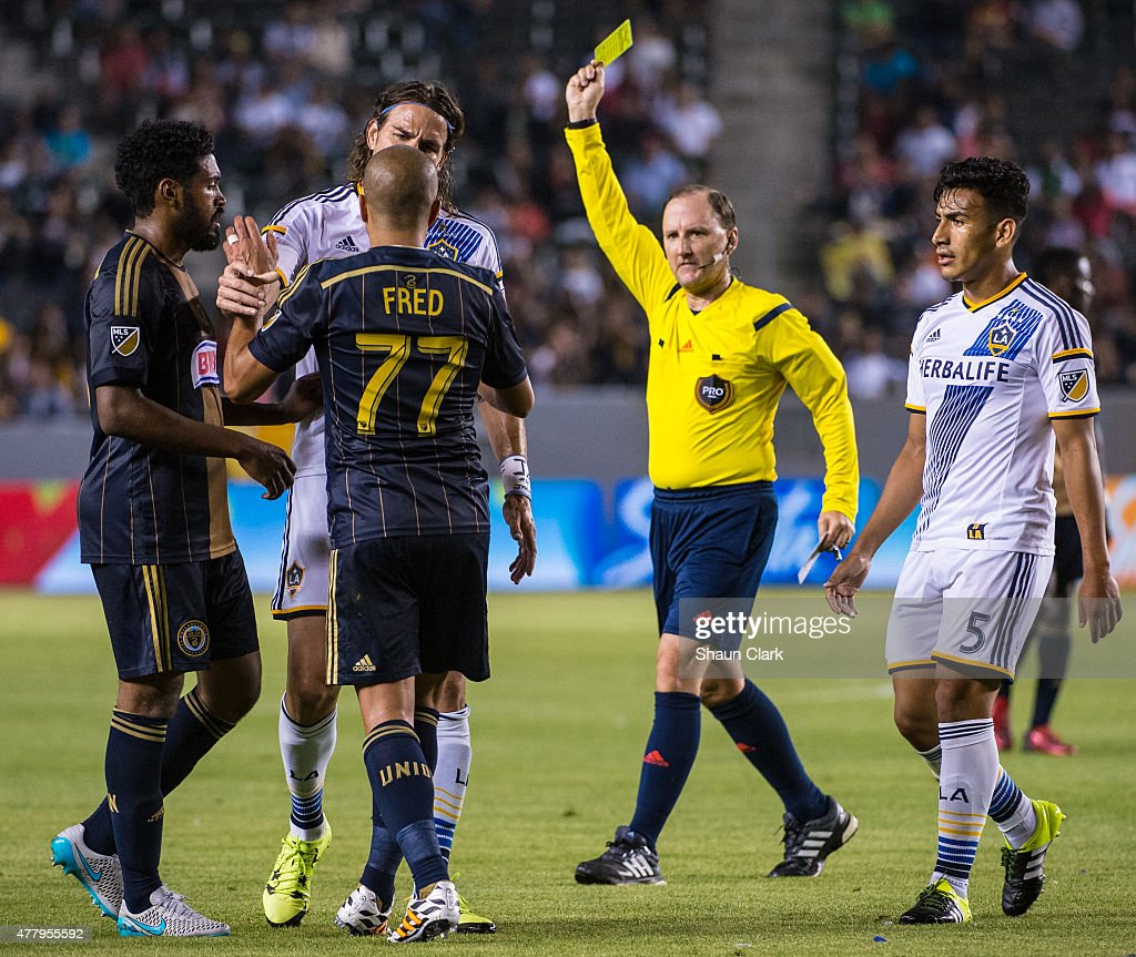 Fred (77) of Philadelphia Union gets a stern talking to by <a gi-track='captionPersonalityLinkClicked' href=/galleries/search?phrase=Alan+Gordon+-+Fu%C3%9Fballspieler&family=editorial&specificpeople=11667134 ng-click='$event.stopPropagation()'>Alan Gordon</a> (9) of Los Angeles Galaxy and a yellow card after a hard tackle on <a gi-track='captionPersonalityLinkClicked' href=/galleries/search?phrase=Robbie+Keane&family=editorial&specificpeople=171824 ng-click='$event.stopPropagation()'>Robbie Keane</a> (7) as <a gi-track='captionPersonalityLinkClicked' href=/galleries/search?phrase=Jose+Villarreal+-+US-amerikanischer+Fu%C3%9Fballspieler&family=editorial&specificpeople=12453250 ng-click='$event.stopPropagation()'>Jose Villarreal</a> (5) of Los Angeles Galaxy approaches during Los Angeles Galaxy's match against Philadelphia Union at the StubHub Center on June 20, 2015 in Carson, California. The LA Galaxy won the match 5-1