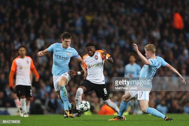 Fred of Shakhtar Donetsk attempts to get past John Stones of Manchester City and Kevin De Bruyne of Manchester City during the UEFA Champions League...