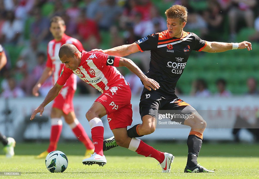 Fred of the Heart and Erik Paartalu of the Roar compete for the ball during the round 15 A-League match between the Melbourne Heart and the Brisbane Roar at AAMI Park on January 6, 2013 in Melbourne, Australia.