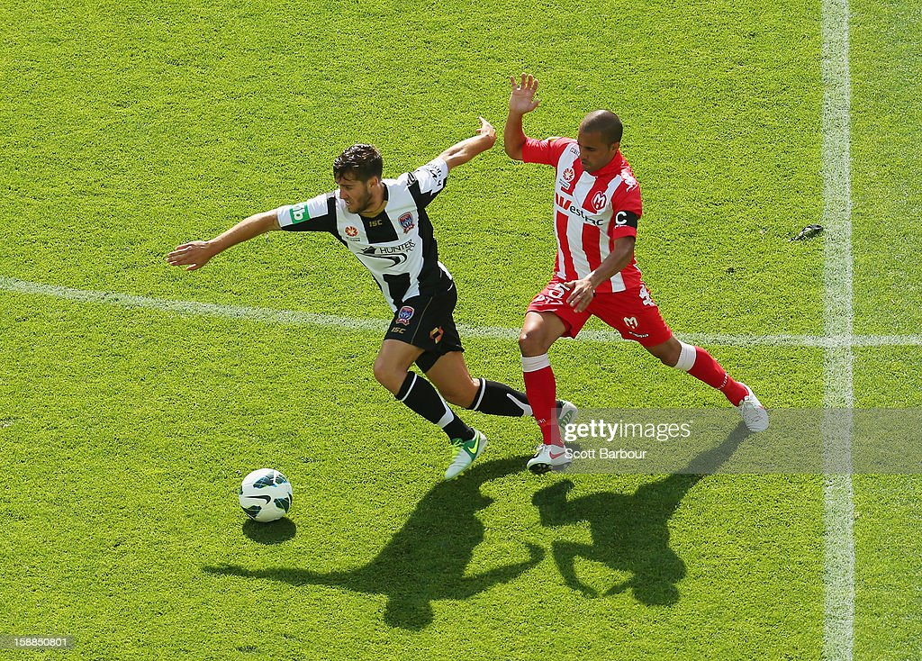 Fred of the Heart and Joshua Brillante of the Jets compete for the ball during the round 14 A-League match between Melbourne Heart and the Newcastle Jets at AAMI Park on January 1, 2013 in Melbourne, Australia.