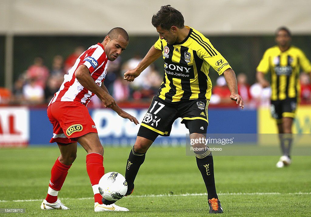 Fred of the Heart and Vince Lia of the Phoenix contest the ball during the round nine A-League match between the Melbourne Heart and the Wellington Phoenix at Latrobe City Sports & Entertainment Complex on December 4, 2011 in Melbourne, Australia.