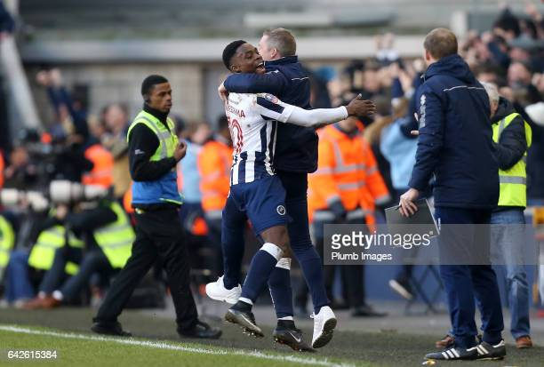 Fred Onyedinma of Millwall celebrates with manager Neil Harris of Millwall after a late goal from Shaun Cummings of Millwall makes it 10 during The...