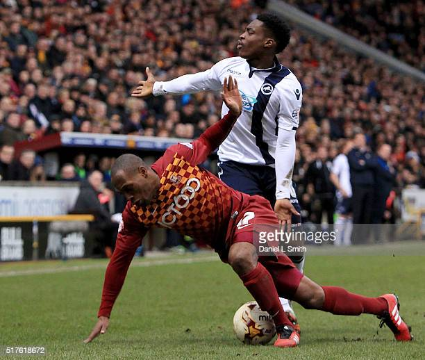 Fred Onyedinma of Millwall FC gestures looks at the referee after a tackle from Kyel Reid of Bradford City AFC during the Sky Bet League One match...