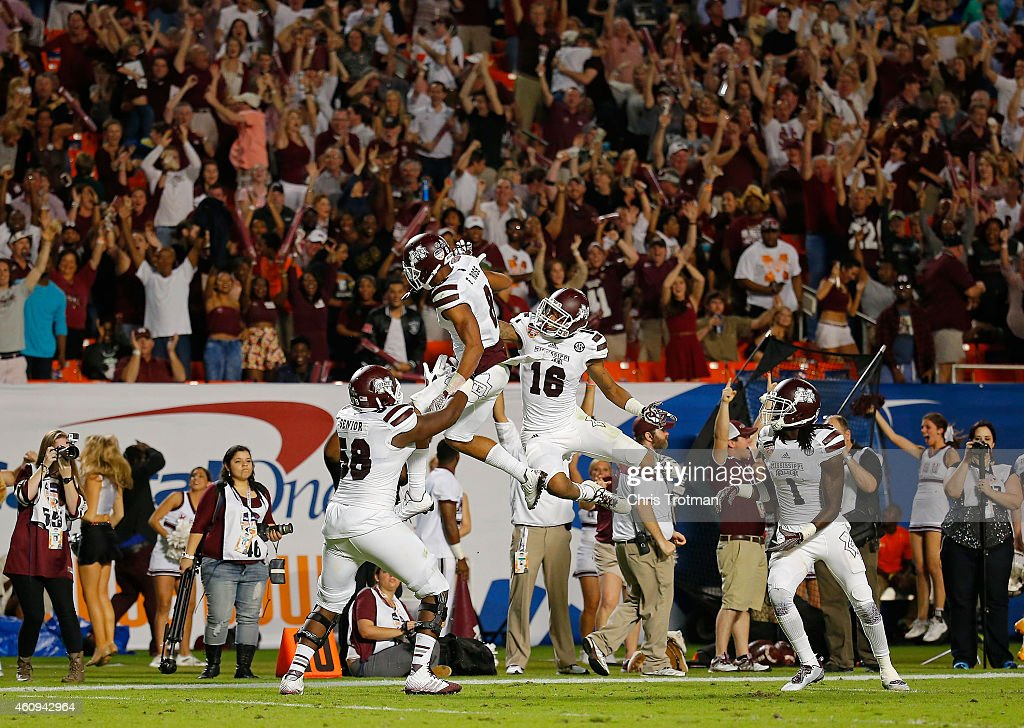 Fred Ross of the Mississippi State Bulldogs celebrates with teammates after scoring a touchdown at the end of the first half of the Capital One...