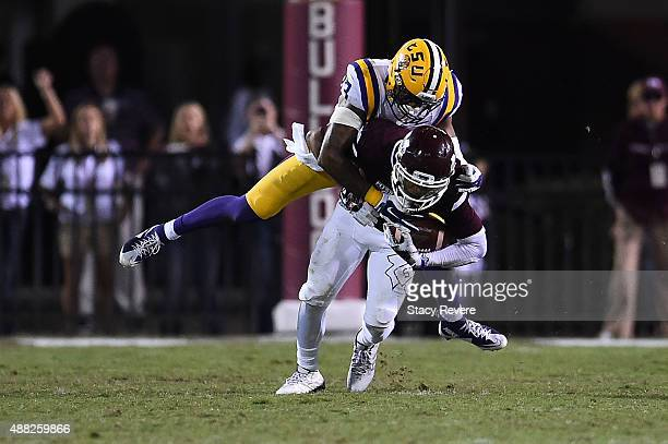 Fred Ross of the Mississippi State Bulldogs is brought down by Jamal Adams of the LSU Tigers during a game at Davis Wade Stadium on September 12 2015...