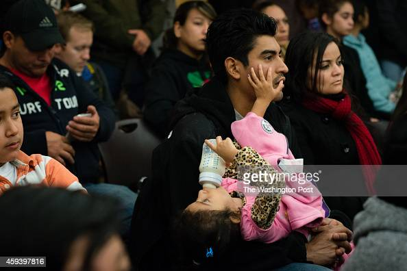 Fred Ruiz of Hyattsville holds his 4yearold daughter Emily Sogia Ruiz He is from Guatemala and has lived in the US for 11 years With the announcement...